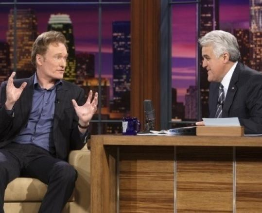A passing of an iconic perch: Jay Leno (right) with Conan O'Brien.