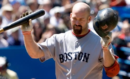 The Red Sox' Kevin Youkilis tosses his bat and helmet away after striking out swinging with a runner on second in the second inning against the Blue Jays.