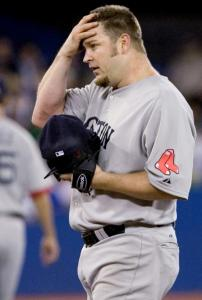Brad Penny wipes his brow during a tough sixth inning, his last of the game and one in which he allowed a home run.