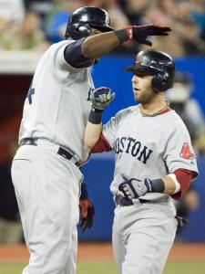 Dustin Pedroia is happy yesterday to be congratulated by David Ortiz for a home run - his first since Opening Day.