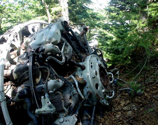 Wreckage from a C-54A transport plane has rested for 65 years on rugged Fort Mountain in Maine.