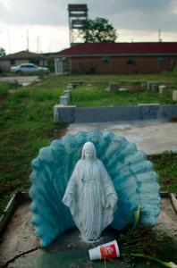 A Virgin Mary statue is all that remains of a home in New Orleans's Lower Ninth Ward. The issue of rebuilding hurricane-ravaged areas of the city has taken on a palpable racial dimension.