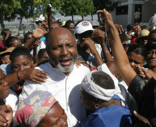 Supporters embraced the Rev. Gerard Jean-Juste in Port-au-Prince, Haiti. He was often considered the Martin Luther King Jr. of Haiti in fighting for civil rights.