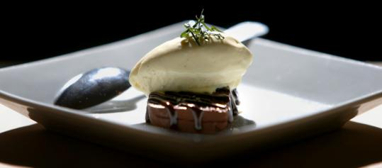 Ten Tables serves a chocolate terrine with a scoop of house-made Thai basil ice cream.