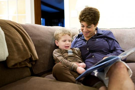 Elaine Lewin, aka 'Gram-E,' read to her grandson Levi Lewin, 3, before bed in Wellesley.