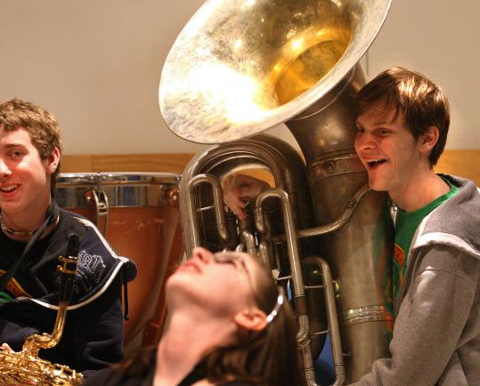 Tim Sullivan (left), Kathryn Long, and James Ball of the Somerville High's band. A legislator wants school bands to sterilize wind instruments.