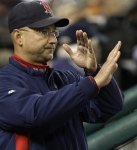 Terry Francona, signaling his fielders in the ninth, got his 500th Red Sox win.