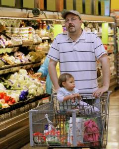 Merchants are realizing that if shoppers, such as Will Sumriex and daughter Autumn in Springfield, Ill., are going to keep spending less, stores need them to come in more frequently.
