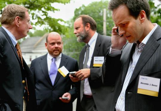 Investor Carl Icahn aims to seat Richard Mulligan (second from right) and Alex Denner (far right) on Biogen Idec's board.