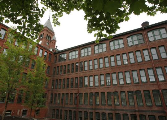 The 19th-century Waltham Watch Factory was originally a concrete building but was replaced by red brick (above).