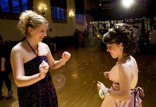 Hailey Gordinear of Woburn (right) danced with teaching assistant Jennifer Fahey at the prom Thursday.