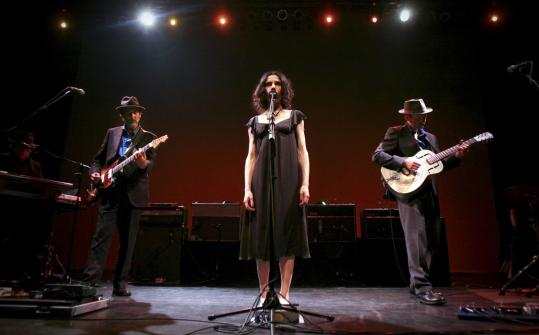 Saturday's show at the House of Blues featured PJ Harvey (center) performing songs from her partnership with John Parish (right).