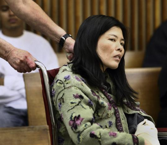 Chi Xue-fang of Quincy is facing charges she killed her 7-month-old fetus and her 9-year-old daughter.