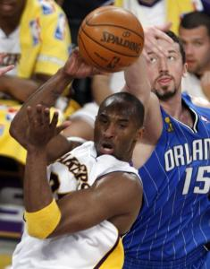 Kobe Bryant passes the ball as Orlando's Hedo Turkoglu tries to knock it away in the first half.