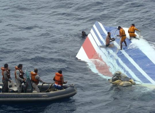 Brazilian Navy sailors recovered debris from the missing Air France jet in the Atlantic. Two US Navy devices capable of picking up the flight recorders' emergency beacons are on the way.