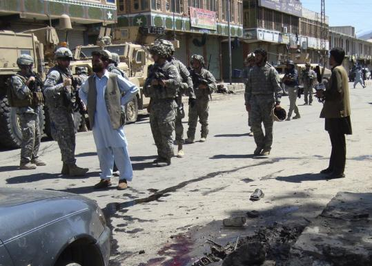US soldiers gathered at the site of a blast yesterday in Asadabad in northeastern Afghanistan.