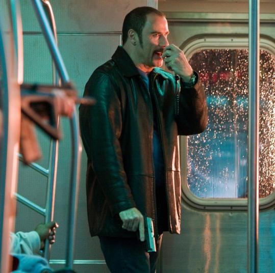 STEPHEN VAUGHAN/COLUMBIA PICTURESJohn Travolta gives an over-the-top performance as a man who hijacks a subway train.