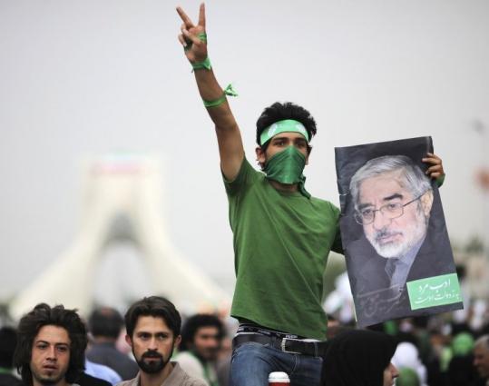 A supporter of presidential candidate Mirhossein Mousavi gestured during a gathering near Tehran's Azadi monument yesterday.