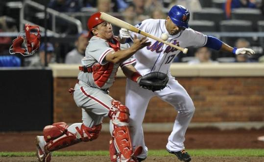 The Phillies unsuccessfully argued interference as catcher Carlos Ruiz and the Mets' Fernando Tatis get tangled as Ruiz tried to field a sacrifice bunt.