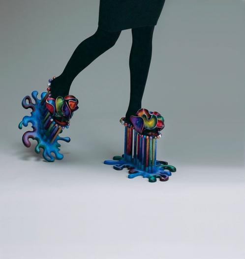 "Marjorie Schick's ""Chopines and Puddles"" is a fantastical evocation, in painted wood, plastic, and papier maché, of a platform shoe popular in Venice and England in the late 16th century."