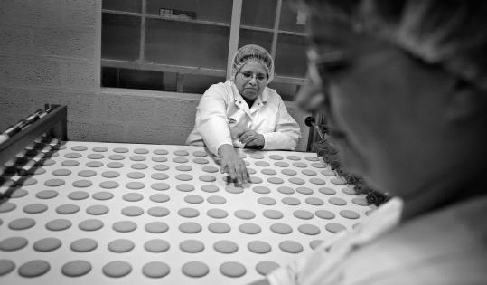 Many workers, such as these in a Belgium biscuit factory, find ways to co