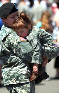 Specialist Amanda Lavallee of Whitinsville bade farewell to her sleeping daughter, Teagan, after a deployment ceremony yesterday at the Charlestown Navy Yard.