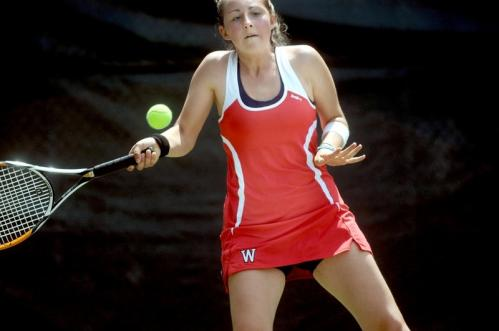 Wellesley's Caroline Taylor returns the ball during a doubles match against Westford Academy.