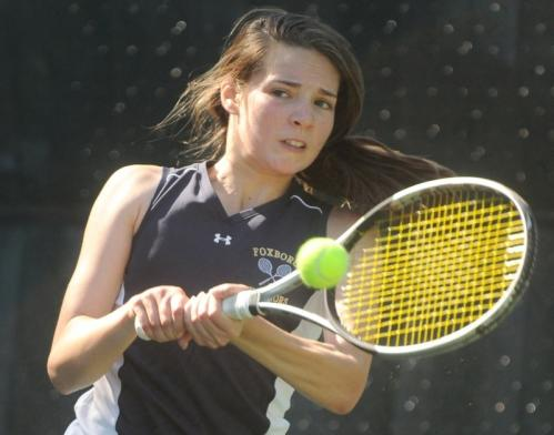Foxboro's Alana Prinos returns the ball during a match against Marlboro's Marina Fileva.