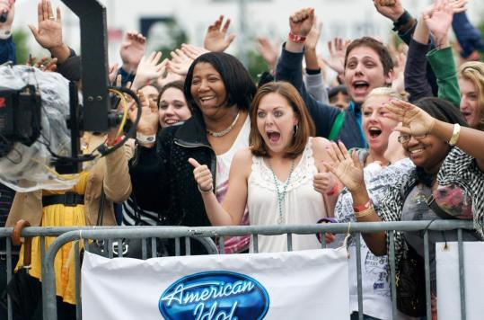 ''American Idol'' hopefuls play to the cameras as they wait to audition for the Fox Network reality show yesterday at Gillette Stadium in Foxborough.