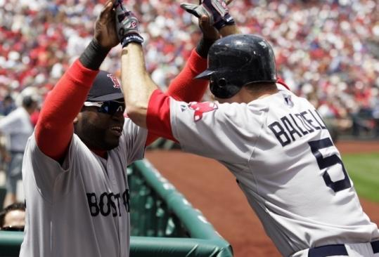 David Ortiz wasn't in the opening lineup, but he was happy to start the celebration for Rocco Baldelli's home run.