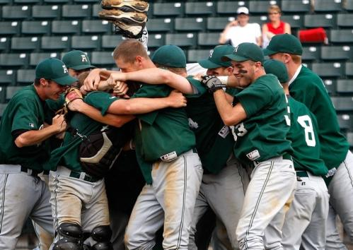 Abington players celebrate near the mound after their title victory.