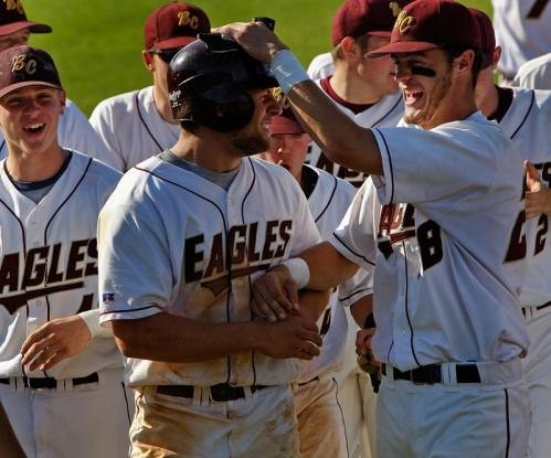 BC High's Tyler Horan (14, center) is congratulated by teammate Billy Kiley (28, right) after his home run blast over the right-field wall in the first inning.