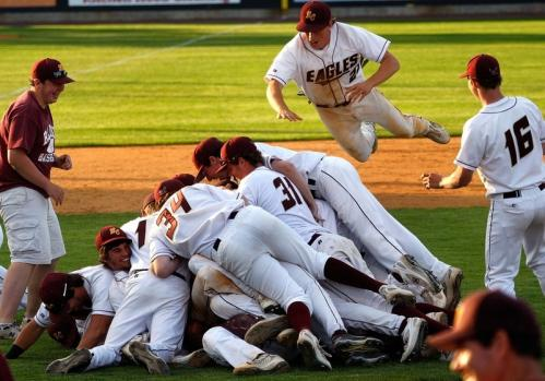 BC High left fielder Billy Hocking (23, top) joins the postgame celebration pileup in the infield.