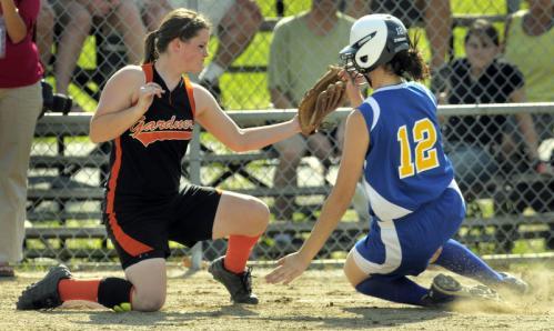 The throw gets past Gardner third baseman Laura Gallagher as Lexington's Alyssa Zahka safely slides into third base during the third inning.