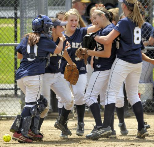 (From left): St. Mary's Erin McAndrews, Jenna Fraher, Angela Dandreo, Samantha Kiley, and Emily Olson celebrate with teammates after defeating Monty Tech in the Division 3 state title game.