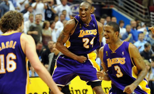 Pau Gasol (left), Kobe Bryant and Trevor Ariza celebrate the Lakers' 15th NBA championship.