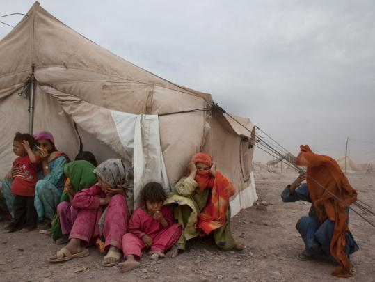 Displaced Pakistanis must fight severe wind and dust conditions at the Jalozai refugee camp. Fighting between the military and the Taliban have driven nearly 3 million from their homes.