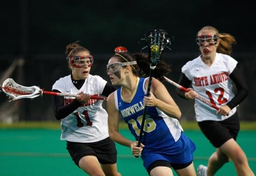 Norwell's Olivia Huie (16) is double covered by North Andover's Jennifer Pino (11) and Kelly O'Connor (12).