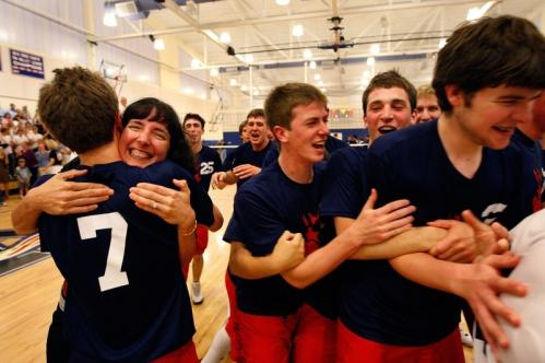 Members of the Lincoln-Sudbury boys' volleyball team embrace following a win over St. John's Prep in the state title game.