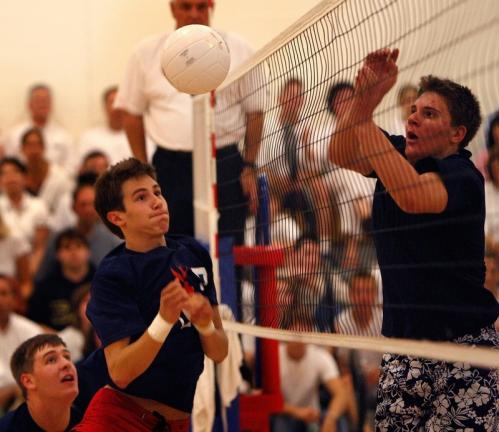 Lincoln-Sudbury's Will Jenkinson (left) goes for the block against St John's Prep.