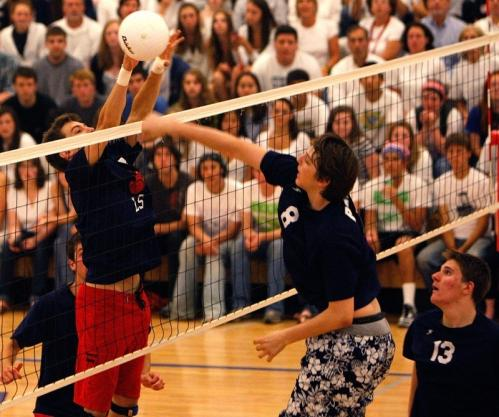 St. John's Prep's Francis Hennessy (8) spikes the ball as Lincoln-Sudbury's Will Jenkinson (7) looks for the block.