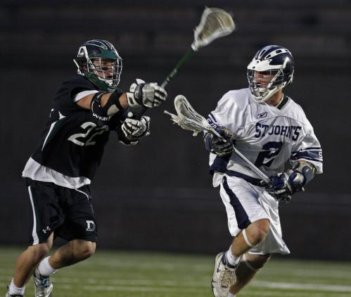 Duxbury's Steven Ripley (left) tries to knock the ball away from St. John's Prep's Ryan Harding.