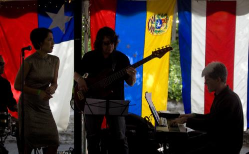 Karina Stone's Quartet entertained festivalgoers against a backdrop of multicolored flags.
