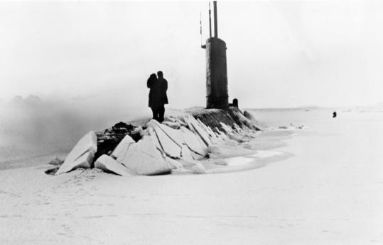 The USS Skate, a nuclear submarine, after breaking through a polar ice pack. At an earlier mission, the sub became the first to surface at the North Pole.