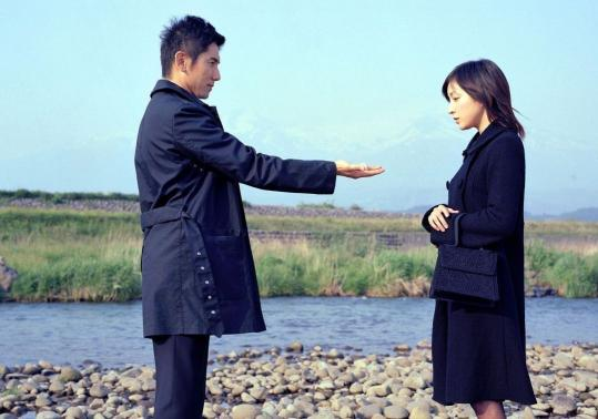 Masahiro Motoki (left) and Ryoko Hirosue costar in 'Departures.'
