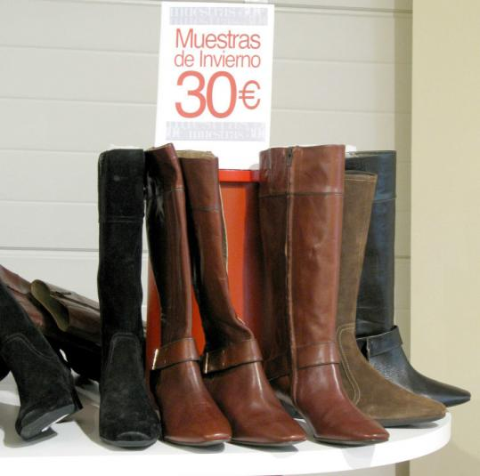 Sample sizes of Pikolinos boots from the previous season are sold at clearance price - about $40 - at the shop-museum.