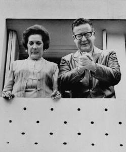 A day after earning the most votes for president of Chile, Salvador Allende and his wife, Hortensia Bussi, greeted reporters from the window of their home in Santiago.