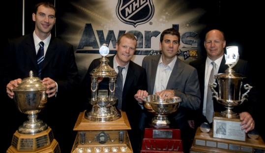 It was a banner night in Las Vegas for Bruins (left to right) Zdeno Chara, Tim Thomas, Manny Fernandez, and Claude Julien, all of whom made a killing with their trophy haul.