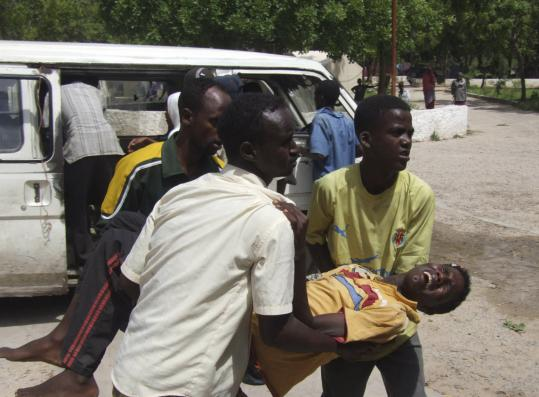 A civilian wounded during fighting in Mogadishu, Somalia, was rushed to a hospital yesterday.