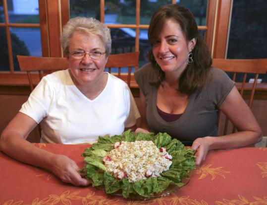 Claire Sirois and her daughter Nicole Stefanelli with Sirois's chicken salad in the kitchen of Stefanelli's Stoneham home.